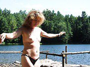 Mature blonde loves to be naked on the lake