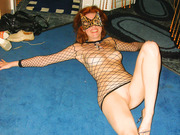 Red head milf with sexy slim figure wearing only fishnet underwear