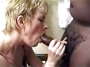 Gorgeous mature blonde momma sucks a black dick in bedroom