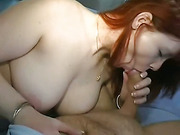 Adorable pale redhead amateur takes on stiff cock in close up